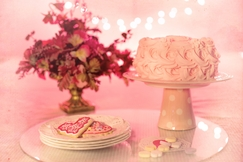 pink icing cake on cake stand valentines
